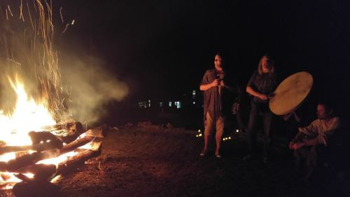 Kris and Damh singing at the fire circle.